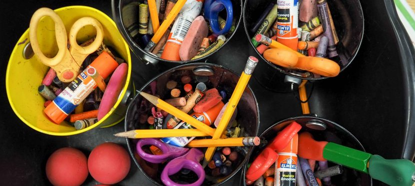 school supplies gathered in a community bucket